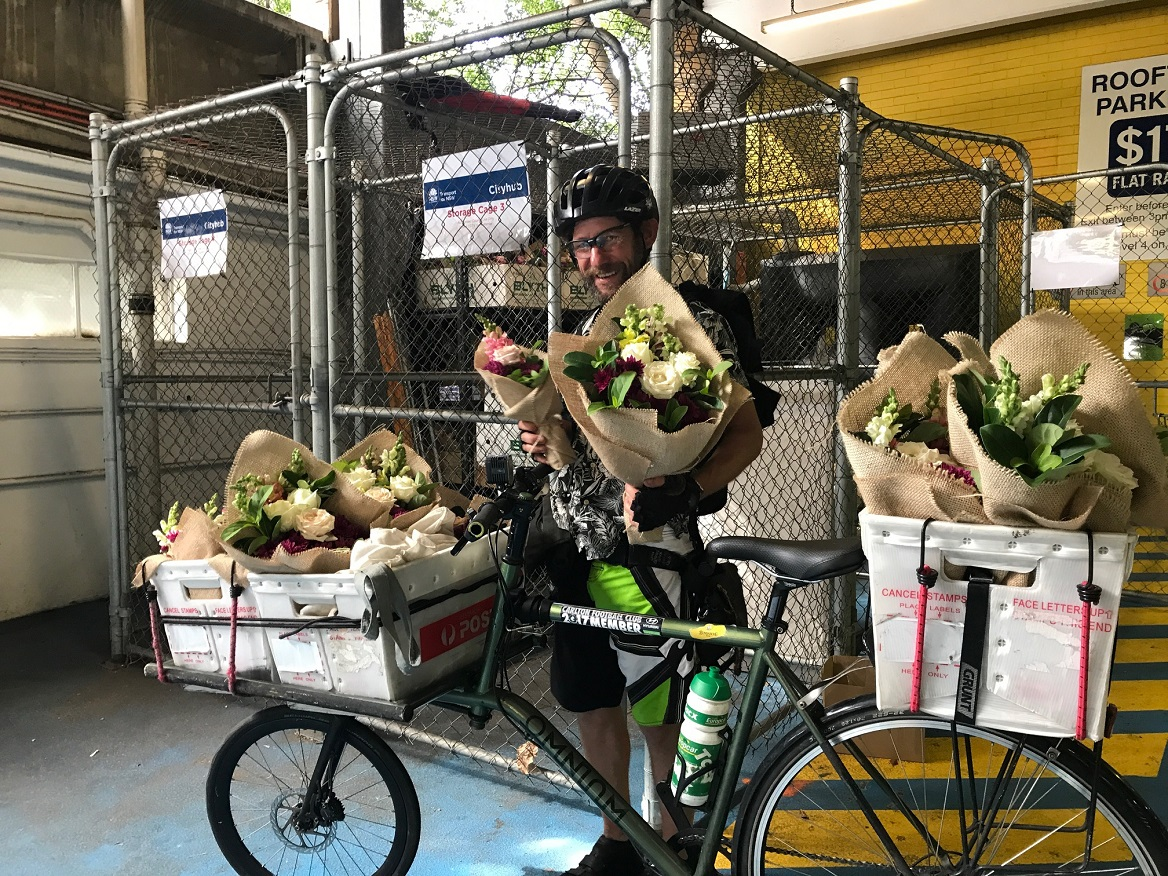 courier delivering valentine's day flowers