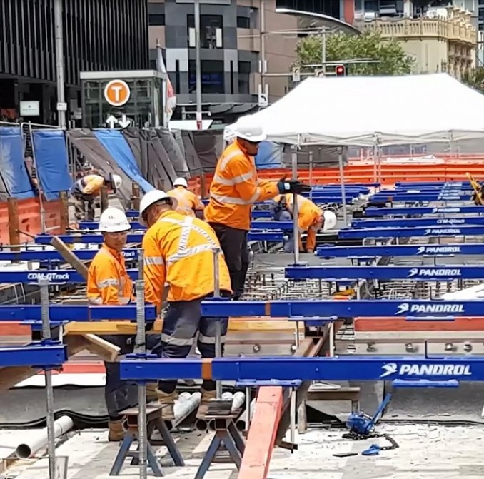 Workers laying light rail tracks in George Street