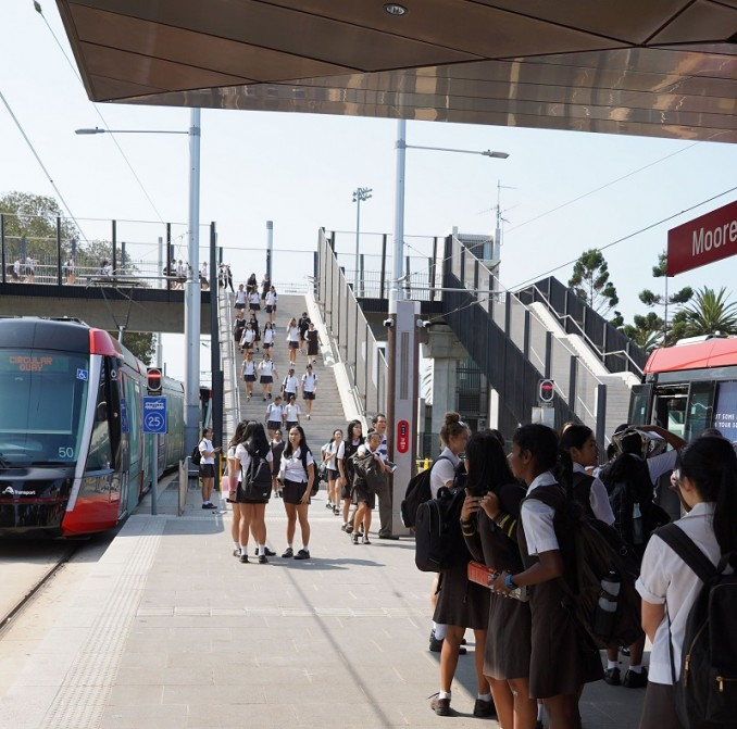 Students at the Moore Park light rail stop