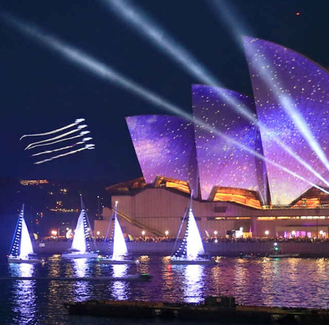 Image of past Australia Day celebrations featuring dazzling lights over Sydney's iconic Opera House