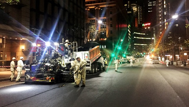 Asphalting taking place on Castlereagh Street in the Sydney CBD