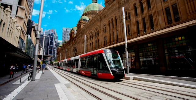 Tram passing alongside QVB