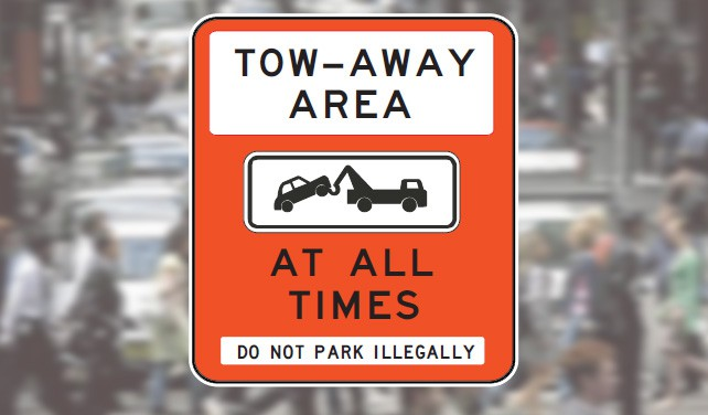 Tow-away area sign